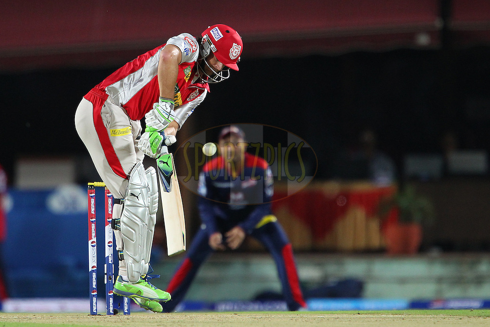 Adam Gilchrist deals with an awkward delivery from Umesh Yadav during match 67 of the Pepsi Indian Premier League between The Kings XI Punjab and the Delhi Daredevils held at the HPCA Stadium in Dharamsala, Himachal Pradesh, India on the on the 16th May 2013..Photo by Ron Gaunt-IPL-SPORTZPICS ..Use of this image is subject to the terms and conditions as outlined by the BCCI. These terms can be found by following this link:..http://www.sportzpics.co.za/image/I0000SoRagM2cIEc