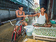 14 AUGUST 2015 - BANGKOK, THAILAND: A Burmese man sells betel to Burmese workers in Saphan Pla fish market in Bangkok. The workers in the market are Thai and Burmese but only the Burmese still chew betel. Chewing betel was banned by Thai Prime Minister Field Marshal Plaek Pibulsonggram in 1942 and only very old Thais, mostly women, still chew betel in Thailand. Saphan Pla fish market is the wholesale fish market that serves Bangkok. Most of the fish sold in Saphan Pla is farmed raised fresh water fish. The market is open 24 hours but it's busiest in the middle of the night and then again from about 7.30 until 11 in the morning.       PHOTO BY JACK KURTZ
