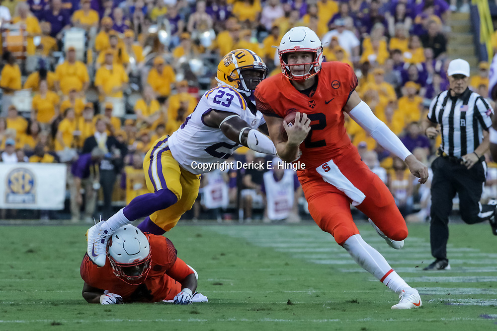 Sep 23, 2017; Baton Rouge, LA, USA; Syracuse Orange quarterback Eric Dungey (2) runs past LSU Tigers linebacker Corey Thompson (23) during the first quarter of a game at Tiger Stadium. Mandatory Credit: Derick E. Hingle-USA TODAY Sports