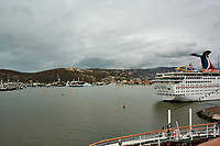 "(Image six of eight). Panorama of the Ensenada harbor in Mexico on a grey and raining day from the deck of the MV World Odyssey. The other cruse ship is the Carnival Imagination. Once all of the students, faculty, staff, and life long learners were aboard we would be ready to begin the 102 day ""round the world"" Semester at Sea Spring 2016 Voyage. Composite of eight images taken with a Nikon N1 V3 camera and 10-30 mm lens (ISO 200, 10 mm, f/11, 1/250 sec). Panorama stitched using AutoPano Giga Pro."