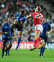 Mathieu Bastareaud of France beats Harry Jones of Canada to the high ball  - Mandatory byline: Joe Meredith/JMP - 07966386802 - 01/10/2015 - Rugby Union, World Cup - Stadium:MK -Milton Keynes,England - France v Canada - Rugby World Cup 2015