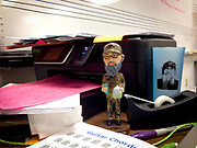 Duck Dynasty bobblehead on the desk of the music teacher at Swan River School