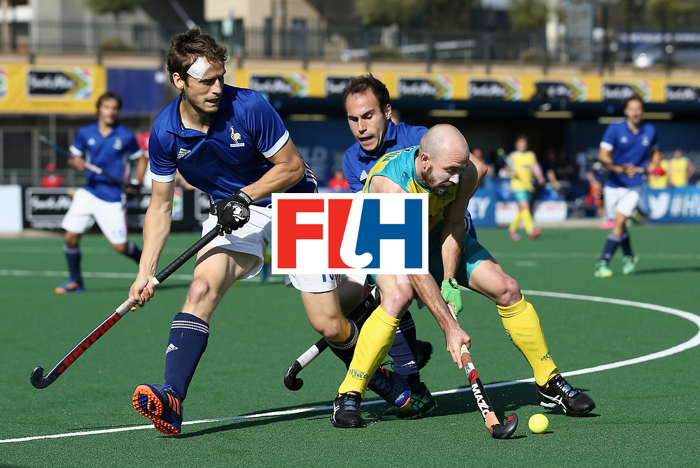 JOHANNESBURG, SOUTH AFRICA - JULY 11: Tom Wickham of Australia battles for possession with Jean-Baptiste Forgues of France and Pieter van Straaten of France  during day 2 of the FIH Hockey World League Semi Finals Pool A match between Australia and France at Wits University on July 11, 2017 in Johannesburg, South Africa. (Photo by Jan Kruger/Getty Images for FIH)