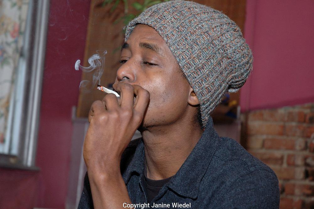 Young man Smoking cannabis