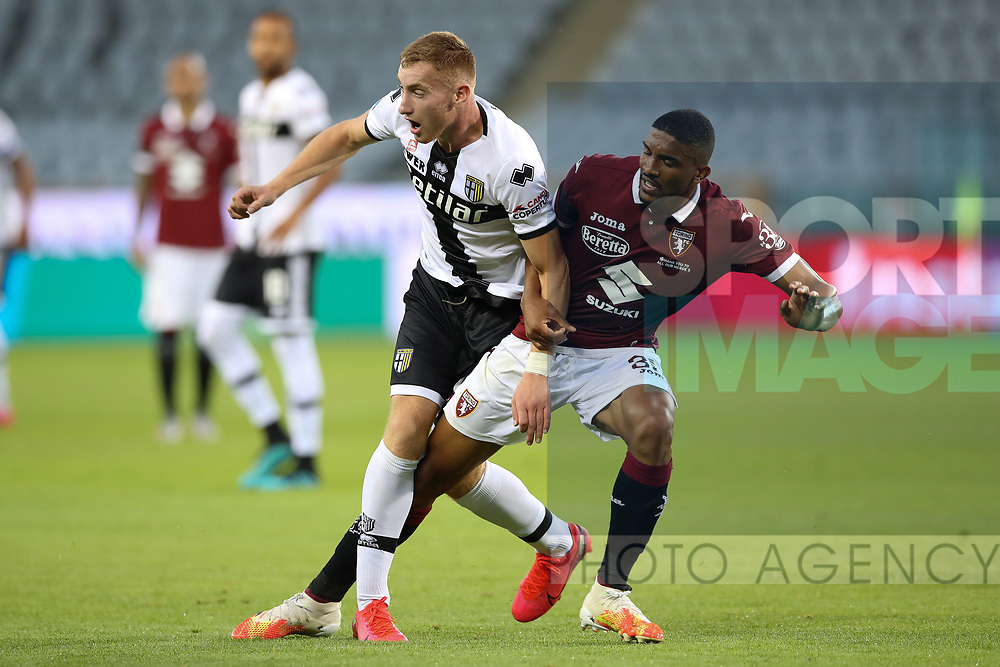 Parma Calcio's Swedish midfielder Dejan Kulusevski collides with Torino FC's Brazilian defender Gleison Bremer during the Serie A match at Stadio Grande Torino, Turin. Picture date: 20th June 2020. Picture credit should read: Jonathan Moscrop/Sportimage