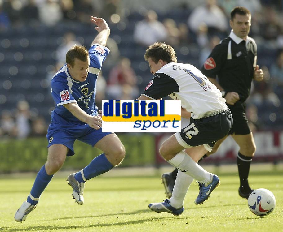 Photo: Aidan Ellis.<br /> Preston North End v Cardiff City. Coca Cola Championship. 09/09/2006.<br /> Cardiff's Paul Parry looks to take on Preston's Sean St Ledger