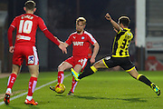 Chesterfield FC defender Liam O'Neil and Burton Albion forward Mason Bennett challenge for the ball during the Sky Bet League 1 match between Burton Albion and Chesterfield at the Pirelli Stadium, Burton upon Trent, England on 12 February 2016. Photo by Aaron Lupton.