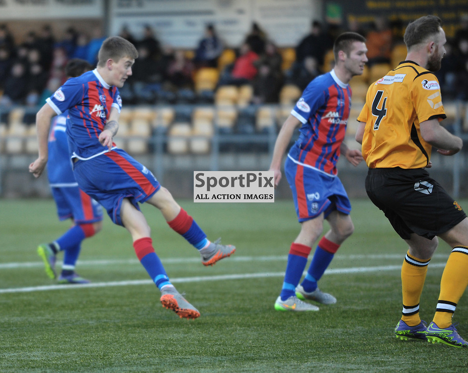 Kyle Macleod  (Elgin City, blue &amp; red) scores to make it 3-1<br /> <br /> Annan Athletic v Elgin City, SPFL League 2, 30th January 2016<br /> <br /> (c) Alex Todd   SportPix.org.uk