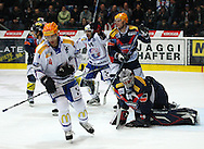 ZSC Lions forward Domenico Pittis (front) and his teammate Pascal Mueller (#14) celebrate after scoring a goal to the score of 2-1 against Kloten Flyers goaltender Ronnie Rueeger (R) and Tommi Santala (2nd R, yellow hlemet) during ice hockey game five of the Swiss National League A Playoff Quarterfinal between Kloten Flyers and ZSC Lions held at the Kolping Arena in Kloten, Switzerland, Tuesday, March 8, 2011. (Photo by Patrick B. Kraemer / MAGICPBK)