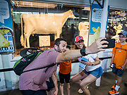 "08 AUGUST 2019 - DES MOINES, IOWA: A family poses for a selfie in front of the ""butter cow"" statue on the first day of the Iowa State Fair. The butter cow is carved out of Iowa butter. The Iowa State Fair is one of the largest state fairs in the U.S. More than one million people usually visit the fair during its ten day run. The 2019 fair run from August 8 to 18.           PHOTO BY JACK KURTZ"