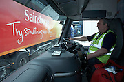An HGV driver is ready to leave Sainsbury's 700,000 sq ft (57,500sq m) supermarket distribution depot at Waltham Poiint