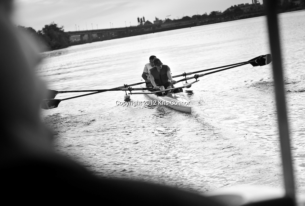 A coach critiques Dana and Joe on their stroke to help them improve their rowing during an afternoon practice on September 5th.