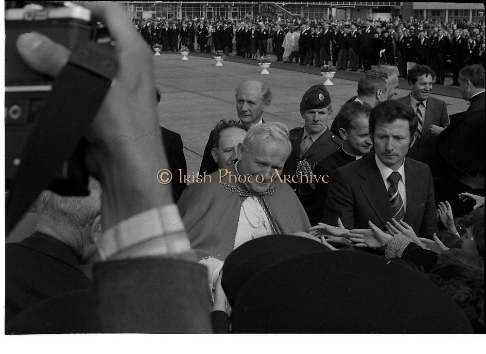 Pope John-Paul II visits Ireland..1979..29.09.1979..09.29.1979..29th September 1979..Today marked the historic arrival of Pope John-Paul II to Ireland. He is here on a three day visit to the country with a packed itinerary. He will celebrate mass today at a specially built altar in the Phoenix Park in Dublin. From Dublin he will travel to Drogheda by cavalcade. On the 30th he will host a youth rally in Galway and on the 1st Oct he will host a mass in Limerick prior to his departure from Shannon Airport to the U.S..Image of The Pope meeting with some of the children who were lucky enough to be able to attend at his arrival at Dublin Airport.