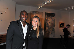 SOL CAMPBELL and his wife FIONA BARRATT at a 2nd private view of the Pavilion of Art & Design London 2011 held in Berkeley Square, London on 11th October 2011.