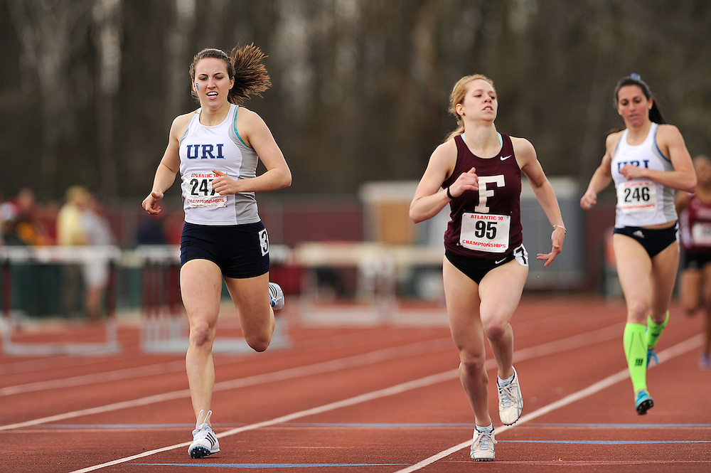 AMHERST, MA - MAY 3: Lauren Burke of the University of Rhode Island (247) and Melissa Higgins of Fordham University (95) cross the finish line of the women's 800 meter run during Day 1 of the Atlantic 10 Outdoor Track and Field Championships at the University of Massachusetts Amherst Track and Field Complex on May 3, 2014 in Amherst, Massachusetts. (Photo by Daniel Petty/Atlantic 10)