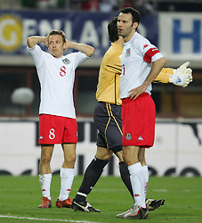 VIENNA, AUSTRIA - WEDNESDAY MARCH 30th 2005: Wales' Craig Bellamy rues a miss against Austria as captain Ryan Giggs (R) looks dejected during the World Cup Qualifying Group Six match at the Ernst Happel Stadium. (Pic by David Rawcliffe/Propaganda)