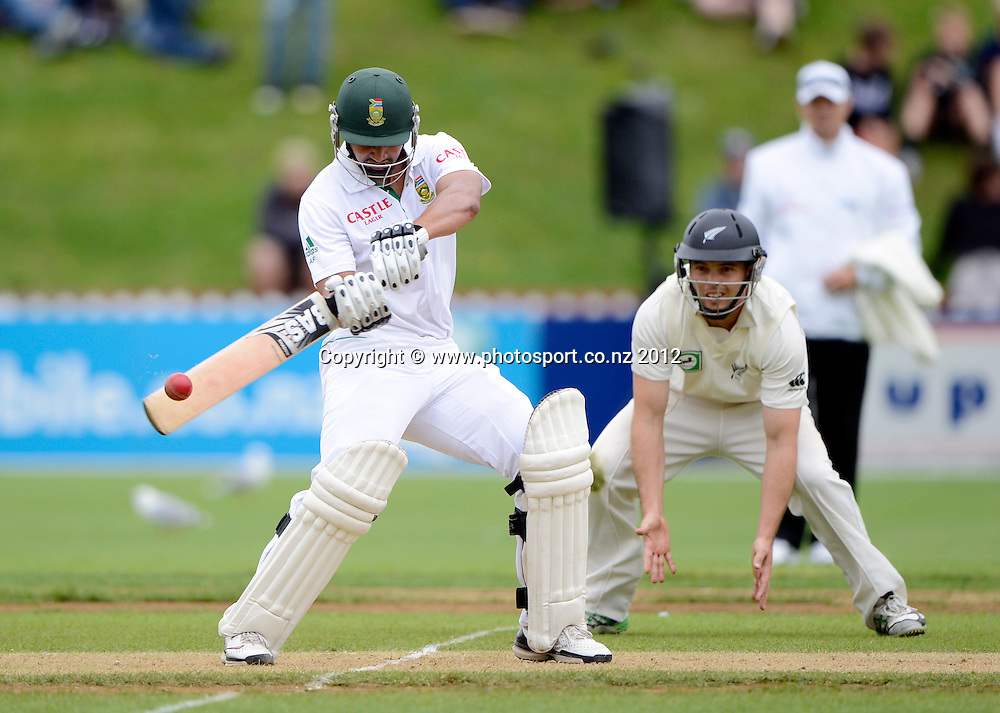 South Africa's Alviro Petersen cuts as Daniel Flynn looks on. Test match cricket. Third Test, Day 2. New Zealand Black Caps versus South Africa Proteas, Basin Reserve, Wellington, New Zealand. Saturday 24 March 2012. Photo: Andrew Cornaga/Photosport.co.nz