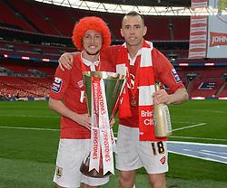 Bristol City's Aaron Wilbraham and Bristol City's Luke Ayling celebrate their win with the Johnstone Paint Trophy - Photo mandatory by-line: Dougie Allward/JMP - Mobile: 07966 386802 - 22/03/2015 - SPORT - Football - London - Wembley Stadium - Bristol City v Walsall - Johnstone Paint Trophy Final