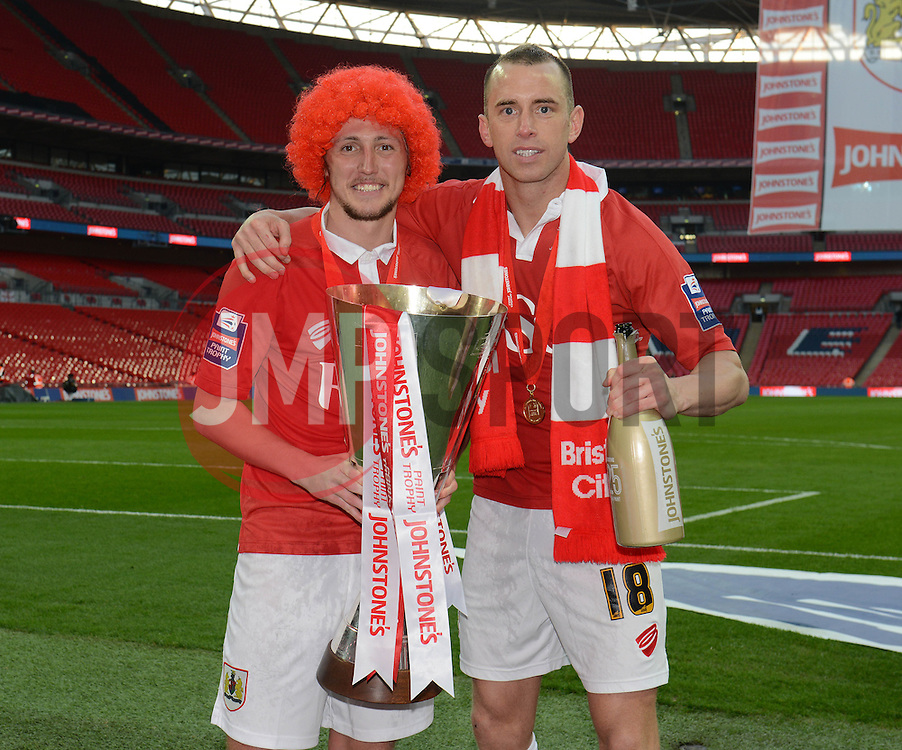 Bristol City's Aaron Wilbraham and Bristol City's Luke Ayling celebrate their win with the Johnstone Paint Trophy - Photo mandatory by-line: Dougie Allward/JMP - Mobile: 07966 386802 - 22/03/2015 - SPORT - Football - London - Wembley Stadium - Bristol City v Walsall - Johnstone Paint Trophy Final