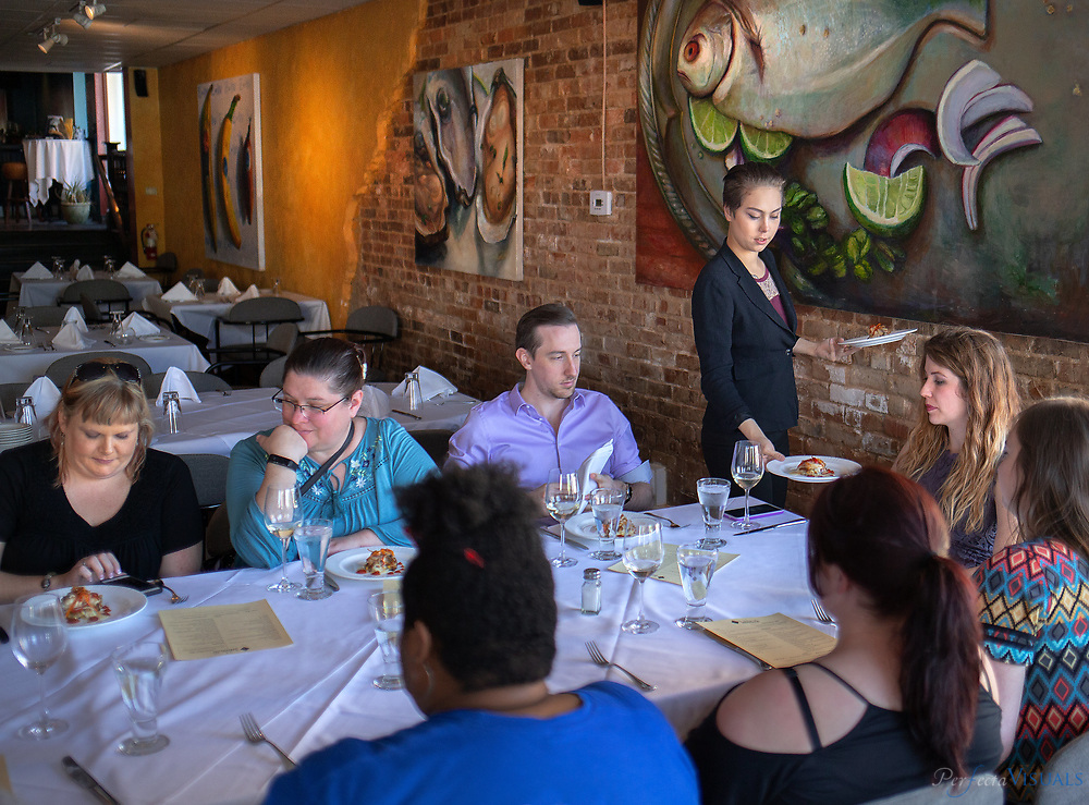 Catrena Barber serves food tour participants at Table 16.<br /> <br /> Photographed, Saturday, April 21, 2018, in Greensboro, N.C. JERRY WOLFORD and SCOTT MUTHERSBAUGH / Perfecta Visuals