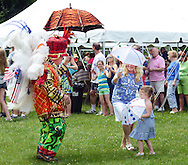 Jamie Caldwell of the Uptown String Band dances with lie McGuire (C) andEmery Misterman 4 of yardley, Pennsylvania during St. John the Evangelist's 50th Anniversary picnic celebration Sunday June 14, 2015 in Lower Makefield, Pennsylvania.  (Photo by William Thomas Cain/Cain Images)