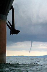 UK WALES SEVERN ESTUARY 21JUN04 - A Tornado hovers over the Bristol coast during a morning of freak weather in the UK. ....jre/Photo by Jiri Rezac ....© Jiri Rezac 2004....Contact: +44 (0) 7050 110 417..Mobile:  +44 (0) 7801 337 683..Office:  +44 (0) 20 8968 9635....Email:   jiri@jirirezac.com..Web:    www.jirirezac.com....© All images Jiri Rezac 2004 - All rights reserved.