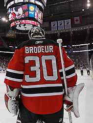 Dec 16, 2009; Newark, NJ, USA; New Jersey Devils goalie Martin Brodeur (30) during the first period of their game against the Montreal Canadiens at the Prudential Center. Brodeur is playing his 1029th NHL game, tying Patrick Roy for most all-time by a goaltender.