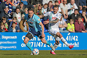James Norwood (Tranmere Rovers) and Gregor Robertson (Grimsby Town) during the Vanarama National League match between Tranmere Rovers and Grimsby Town FC at Prenton Park, Birkenhead, England on 30 April 2016. Photo by Mark P Doherty.