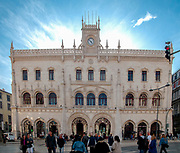 People walking in front of the facade of the Rossio Railway station, Lisbon, Portugal
