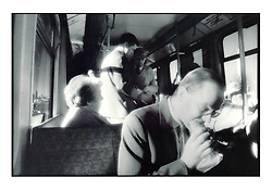 Picture by Mark Larner. Picture shows a man having a hurried lunch on the Docklands Light Railway. 1996
