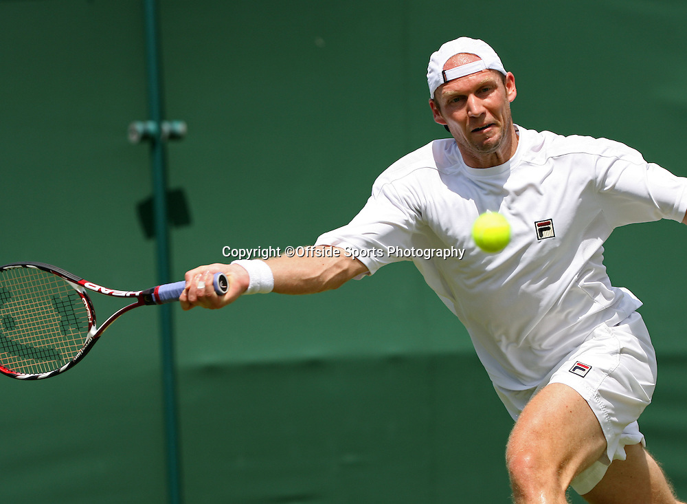 24/06/2009. The All England Lawn Tennis Championships. Rainer Schuettler plays a shot during his 2nd round match with Dudi Sela. Wimbledon, UK. Photo: Offside/Steve Bardens.