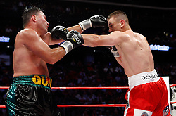 July 11, 2009; Newark, NJ, USA; Tomasz Adamek (red/white) and Bobby Gunn (black/green) trade punches during their 12 round IBF Cruiserweight championship bout at the Prudential Center. Adamek retained his title via 4th round TKO.