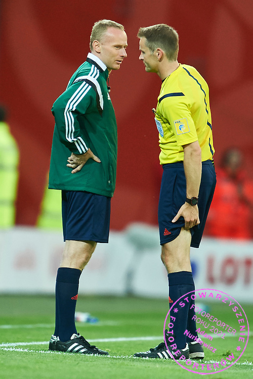 (R) Injured referee Alain Bieri from Switzerland consults with (L) fourth official referee Marcin Borski from Poland during international friendly soccer match between Poland and Greece at PGE Arena Stadium on June 16, 2015 in Gdansk, Poland.<br /> Poland, Gdansk, June 16, 2015<br /> <br /> Picture also available in RAW (NEF) or TIFF format on special request.<br /> <br /> For editorial use only. Any commercial or promotional use requires permission.<br /> <br /> Adam Nurkiewicz declares that he has no rights to the image of people at the photographs of his authorship.<br /> <br /> Mandatory credit:<br /> Photo by &copy; Adam Nurkiewicz / Mediasport