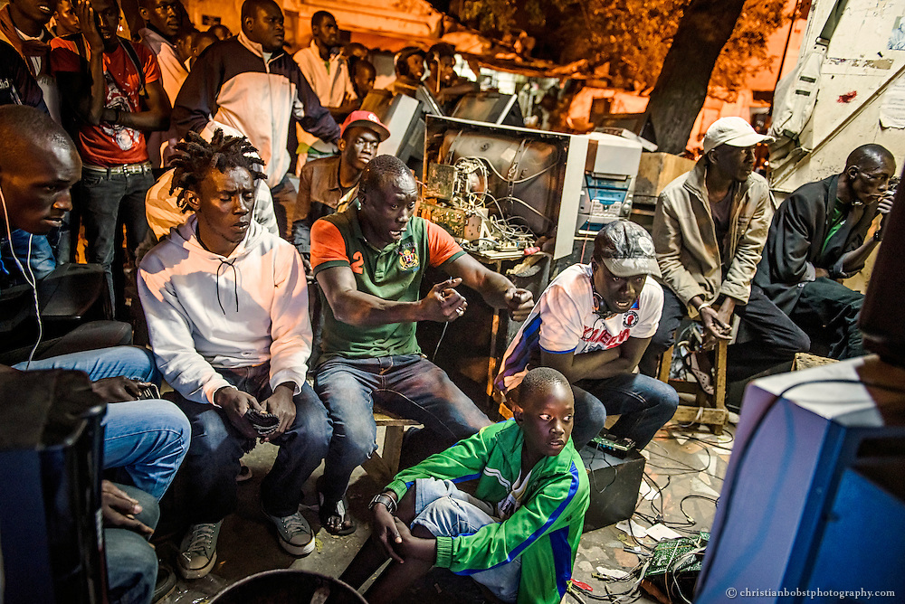 Crowds are gathering in the streets of Dakar to watch the wrestling fights on TV on April 4 2015, the celebration day of Senegalese independence.