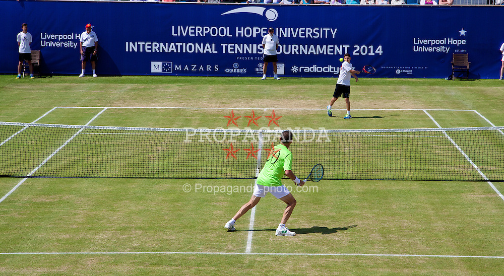 LIVERPOOL, ENGLAND - Sunday, June 22, 2014: A ball-boy gets to play a point during Day Four of the Liverpool Hope University International Tennis Tournament at Liverpool Cricket Club. (Pic by David Rawcliffe/Propaganda)