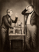 Michael Faraday (1791-1867) English chemist and physicist, left, and John Frederic Daniell (1790-1845) English chemist, physicist and meteorologist. Among his inventions were the Daniell cell, a wet storage battery, and a hygrometer.  Engraving.