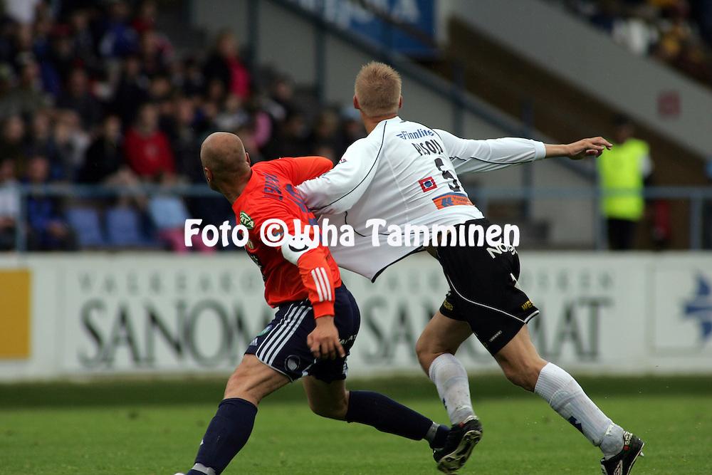 07.07.2005, Tehtaankentt?, Valkeakoski, Finland..Veikkausliiga 2005 / Finnish League 2005.FC Haka v AC Allianssi.Ville Lehtinen (Allianssi) v Juha Pasoja (Haka).©Juha Tamminen.....ARK:k