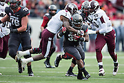 LITTLE ROCK, ARKANSAS - NOVEMBER 23:  Kiero Small #36 of the Arkansas Razorbacks runs the ball and is tackled by Nickoe Whitley #1 of the Mississippi State Bulldogs at War Memorial Stadium on November 23, 2013 in Little Rock, Arkansas.  The Bulldogs defeated the Razorbacks 24-17.  (Photo by Wesley Hitt/Getty Images) *** Local Caption *** Kiero Small; Nickoe Whitley