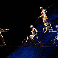 London, UK - 4 January 2012: Acrobats perform on high wires, suspended 15 and 25 feet above the stage during the Cirque Du Soleil Kooza dress rehearsal at the Royal Albert Hall. Since its premiere in April of ..2007, KOOZA has captivated close to four million spectators in North America and Japan.  London will be the first destination of the KOOZA European tour starting the ..5th of January. Written and directed by David Shiner, KOOZA is a return to the origins of Cirque du Soleil combining two circus traditions - acrobatic performance and ..the art of clowning.  KOOZA highlights the physical demands of human performance in all its splendor and fragility, presented in a colorful m&eacute;lange that emphasizes ..bold slapstick humor. This image can be quickly and easily purchased from some of the major international stock agencies:<br />