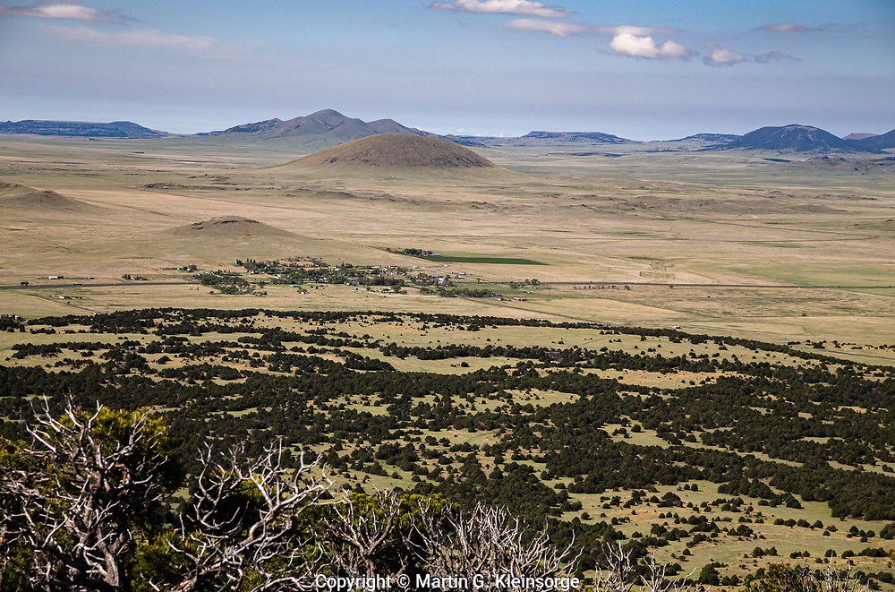 Looking down from the summit of Capulin Volcano, across the plains of northeast New Mexico to the distant cones and mesas.  In the center is the community of Capulin.
