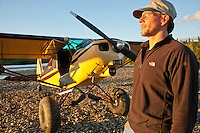 Pilot with a Piper Cub with tundra tires landed near the haedwaters of the Upper Mulchatna River, Western Alaska