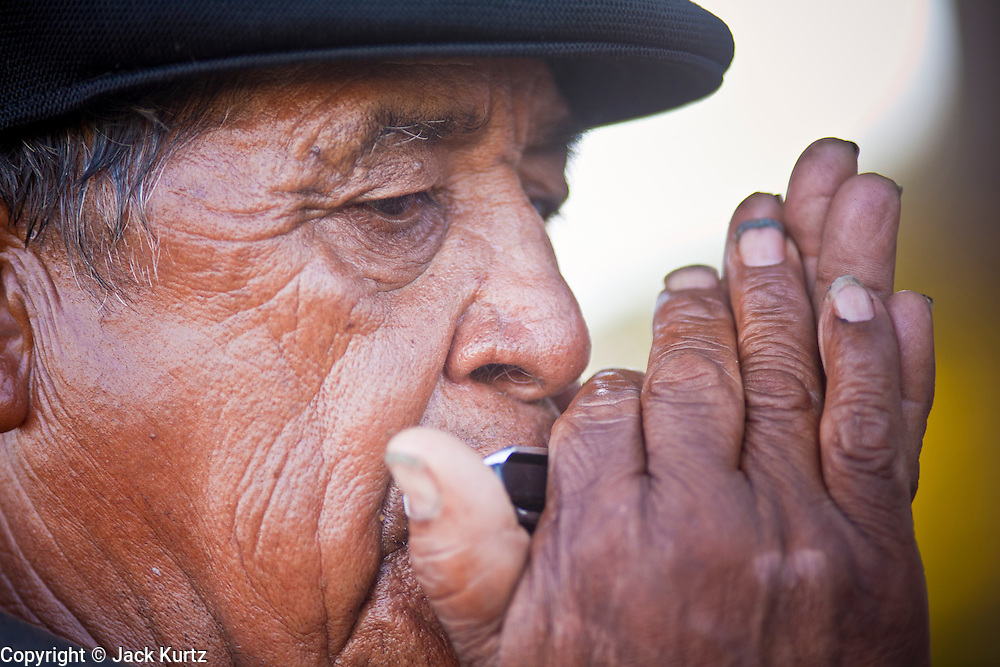 July 6 - PHOENIX, AZ: GERONIMO, the great grandson of the famous Apache leader Geronimo, plays the harmonica during an immigrants' rights prayer vigil in Phoenix Tuesday. Geronimo said he was fighting for the rights of all people and that his wife, an undocumented woman from Mexico, had been deported and he was also fighting for her rights. Immigrant rights' activists have been holding a prayer vigil in opposition to Arizona's tough new anti-illegal immigrant law, SB 1070, which is supposed to take effect on July 29. The bill requires local police and law enforcement agencies to verify the immigration status of people they suspect might be in the US illegally. Opponents of the bill fear it will lead to racial profiling. The US Justice Department announced Tuesday afternoon that they would file suit against Arizona to prevent implementation of SB 1070. They are filing suit on the grounds that immigration enforcement is the exclusive domain of the federal government.       Photo by Jack Kurtz
