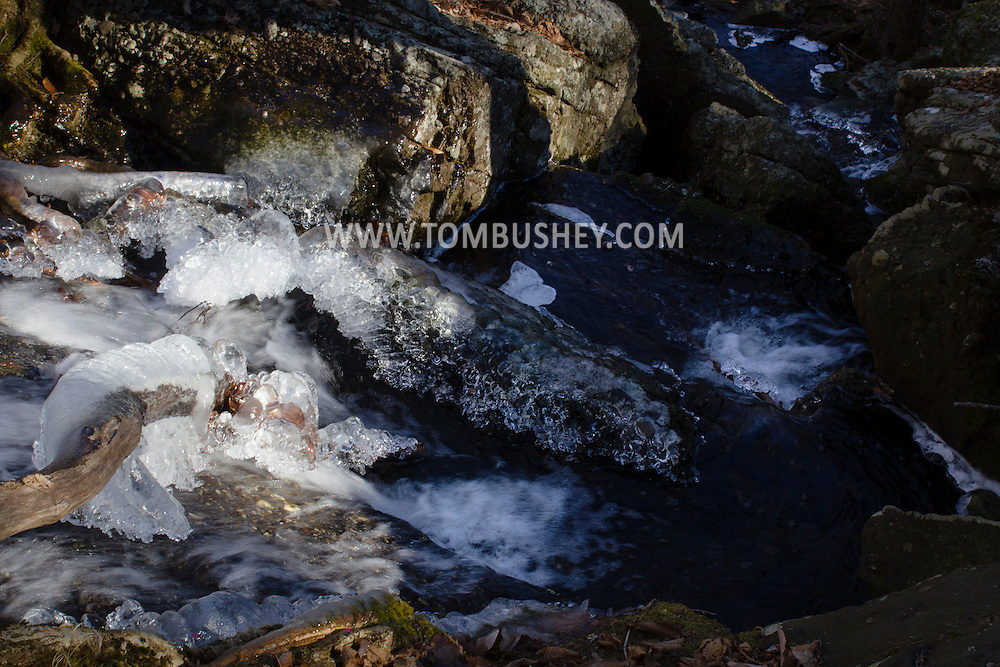 Cornwall, New York  - Ice forms on branches ad rocks as Baby Brook flows down Schunnemunk Mountain on Jan. 1, 2015.