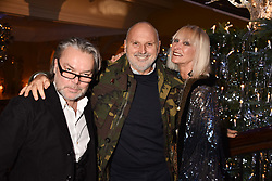 David Downton, Sam McKnight and Virginia Bates at reception to celebrate the launch of the Claridge's Christmas Tree 2017 at Claridge's Hotel, Brook Street, London England. 28 November 2017.