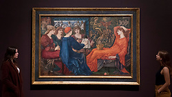 """© Licensed to London News Pictures. 22/10/2018. LONDON, UK. Staff members view """"Laus Veneris"""", 1873-8, by Edward Burne-Jones.  Preview of the largest Edward Burne-Jones retrospective to be held in a generation at Tate Britain.  Burne-Jones was a pioneer of the symbolist movement and the only Pre-Raphaelite to achieve world-wide recognition in his lifetime.  The exhibition runs 24 October to 24 February 2019.  Photo credit: Stephen Chung/LNP"""