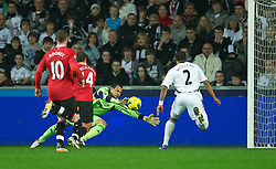 19.11.2011, Liberty Stadion, Swansea, ENG, PL, Swansea City vs Manchester United, 12. Spieltag, im Bild Manchester United's Javier Hernandez scores the first goal against Swansea City's goalkeeper Michael Vorm during the Premiership match at the Liberty Stadium. (Pic by David Rawcliffe/Propaganda). EXPA Pictures © 2011, PhotoCredit: EXPA/ Sportida/ David Rawcliff..***** ATTENTION - OUT OF ENG, GBR, UK *****