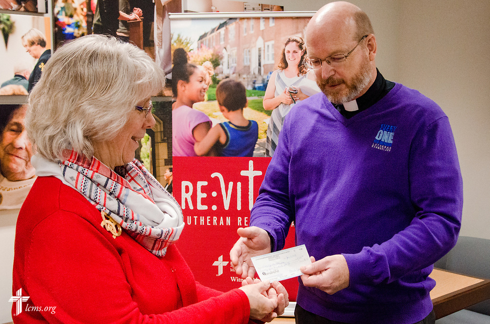 Lisa Asmus, left, president of the LWML South Dakota District, presents a check for $2,500 to the Rev. Dr. Mark Wood, director of LCMS Witness & Outreach Ministry for the LCMS Office of National Mission, on Wednesday, Jan. 24, 2018, at the LCMS International Center in St. Louis. The gift was a South Dakota District mission grant for the 2016-18 biennium, and the funds will be used to for re:Vitality, a comprehensive program to help congregations improve their abilities to invite, welcome and receive people from outside the congregation.LCMS Communications/Frank Kohn