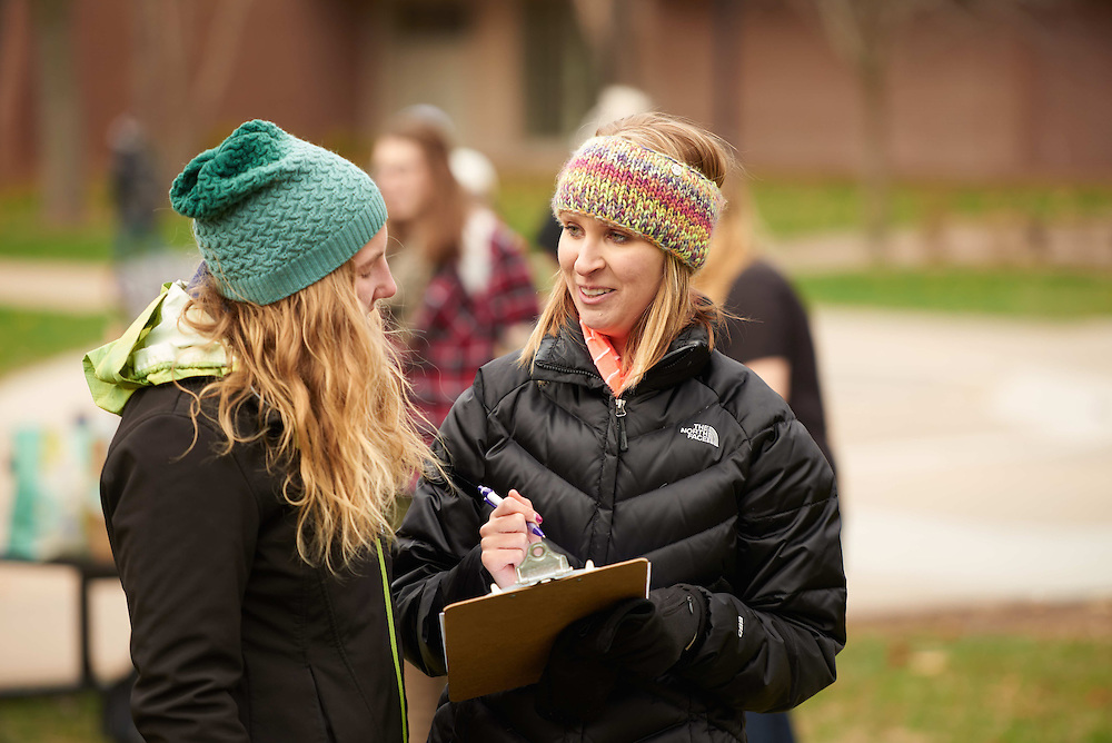 -UWL UW-L UW-La Crosse University of Wisconsin-La Crosse; Candid; Clipboard; cloudy; Community Service; Outside; Smiling; Student students; Talking; Volunteering; Wittich; Woman women