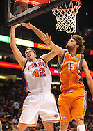 Mar. 26 2010; Phoenix, AZ, USA; New York Knicks center David Lee (42) puts up a shot against Phoenix Suns center Robin Lopez (15) in the first half at the US Airways Center.  Mandatory Credit: Jennifer Stewart-US PRESSWIRE.