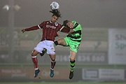 Bristol City Marcus Day(11) and Forest Green Rovers Sam Hendy(36) challenge for a header during the Gloucestershire Senior Cup match between Forest Green Rovers and U23 Bristol City at the New Lawn, Forest Green, United Kingdom on 9 April 2018. Picture by Shane Healey.